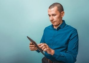 Man with Blue Shirt and iPad